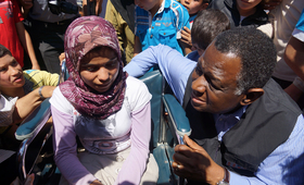 UNFPA Executive Director, Dr. Babatunde Osotimehin, with a Syrian teenage girl with special needs at the Nizip Camp in Turkey. Photo: UNFPA/Nezih Tavlas